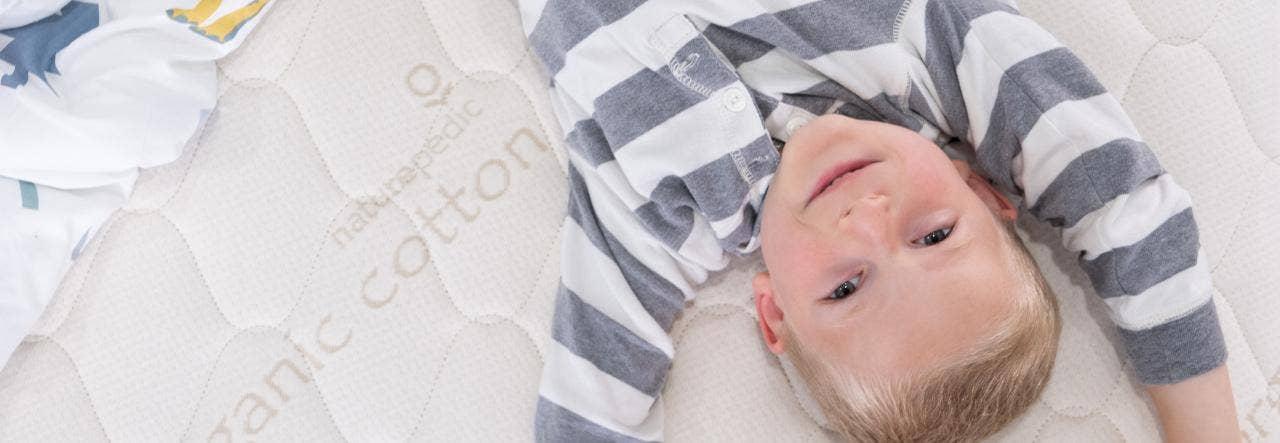 Kid laying on a NP mattress