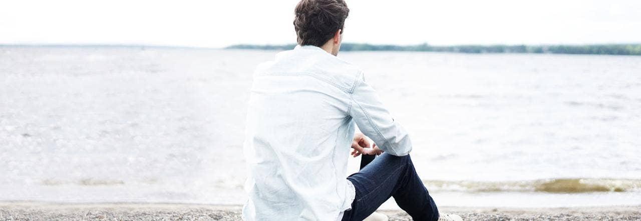 Man sitting alone on beach