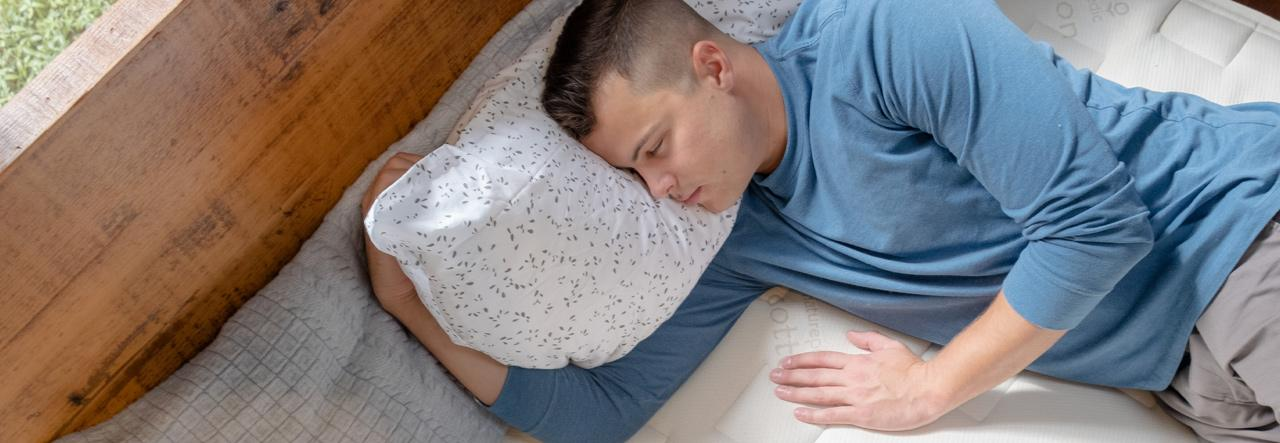 Man asleep on NP mattress