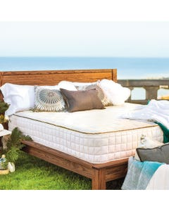 Angled shot of mattress dressed up in outdoor setting