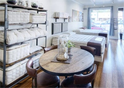 mattresses and accessory rack inside organic mattress gallery in Los Angeles California