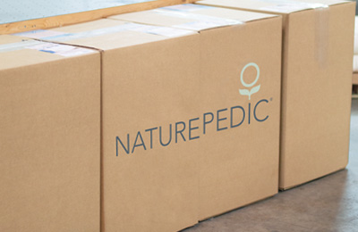 Brown shipping box with Naturepedic label