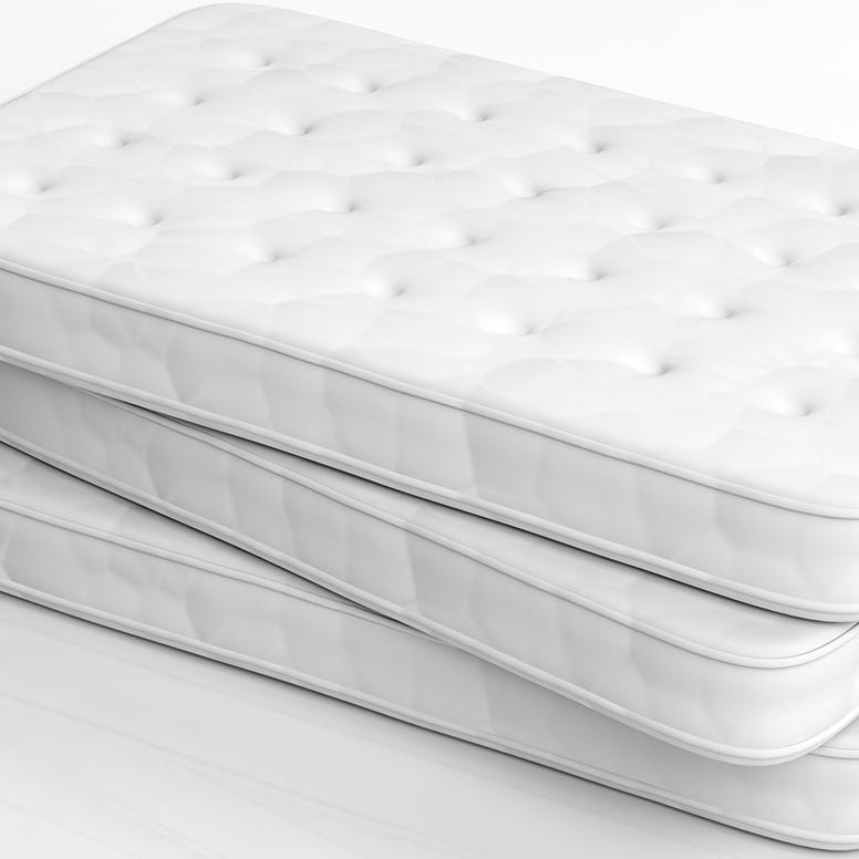 Stack of three conventional twin mattresses