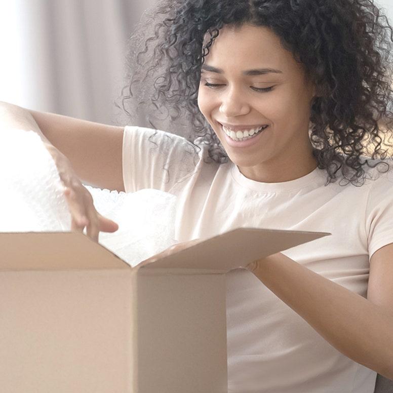 Woman opening shipping box