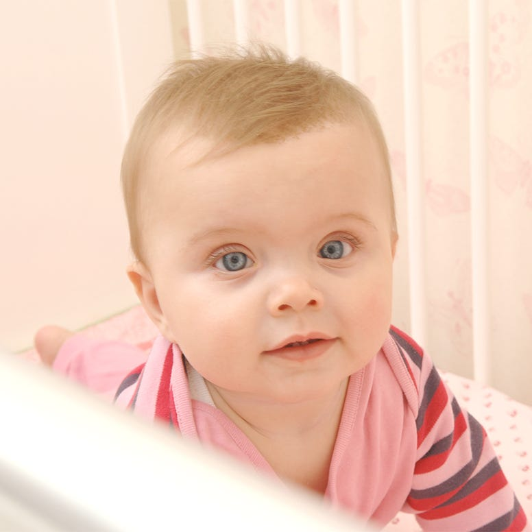 Baby girl in crib looking up