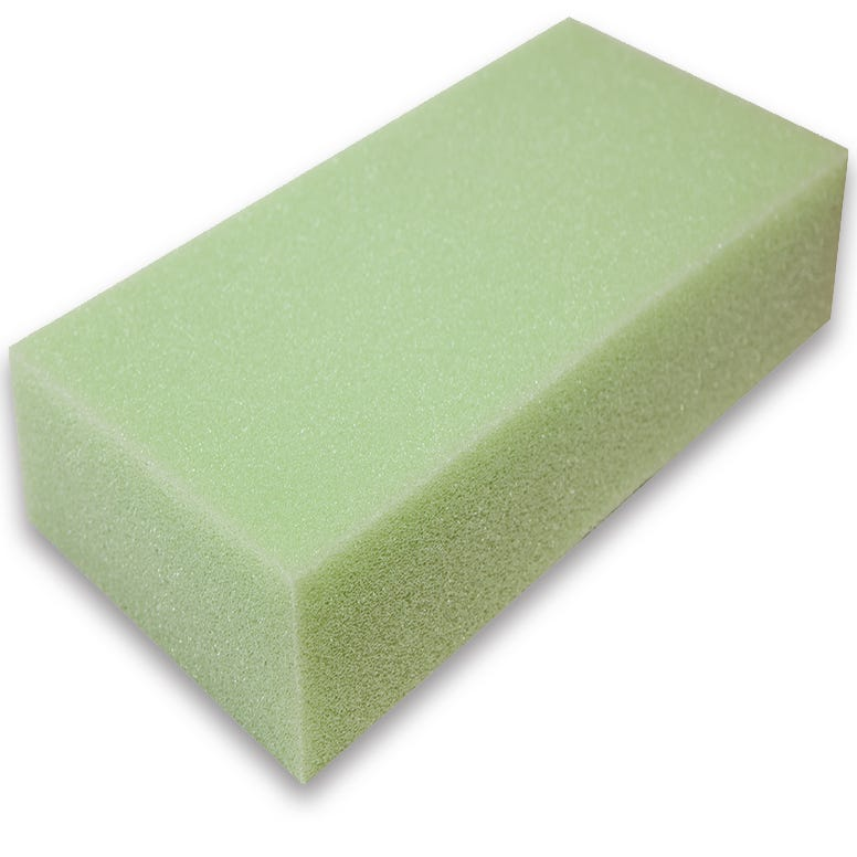 Block of green colored polyurethane foam