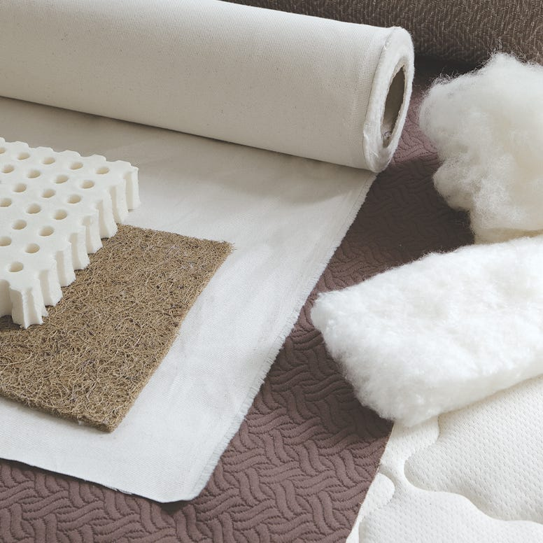 Collection of materials including fabrics, latex, coir, cotton and wool