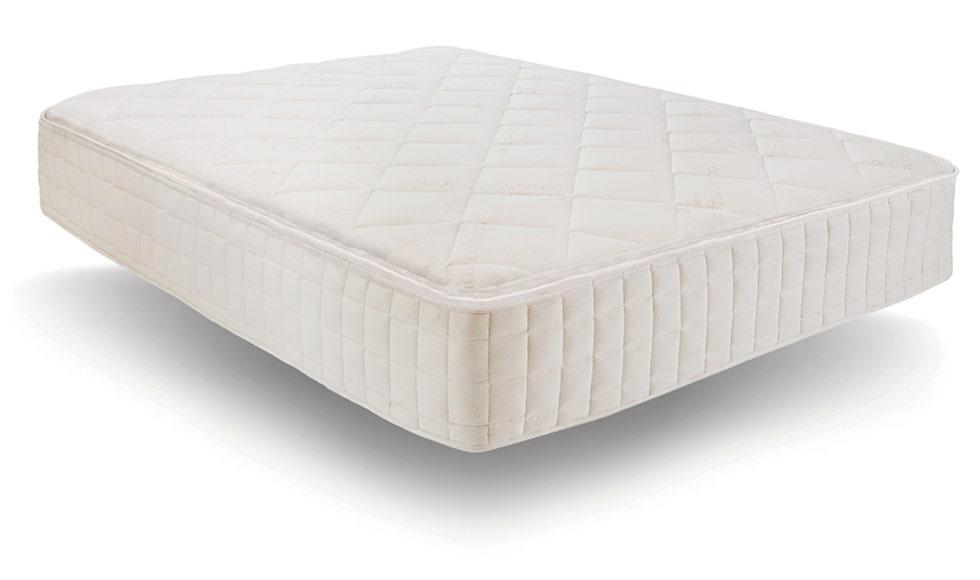 Angled shot of mattress on white background